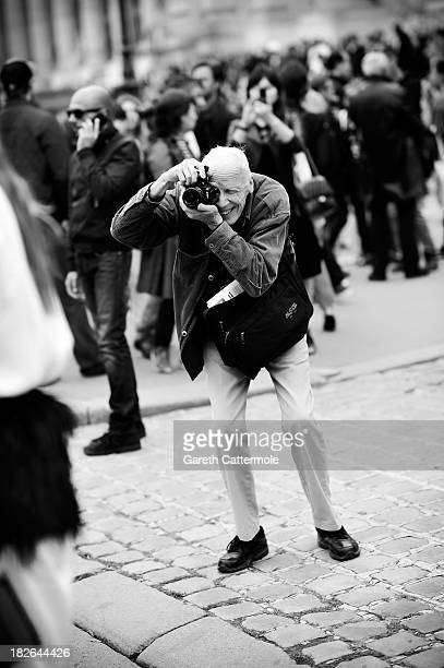Photographer Bill Cunningham working during Paris Fashion Week Womenswear Spring/Summer 2014 on October 1 2013 in Paris France