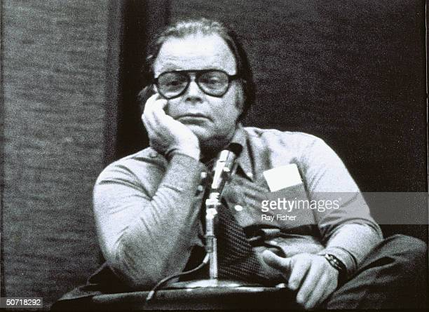 Photographer Bob Adelman looking pensive during a conference