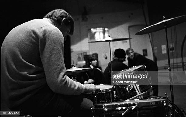 Photographer Bob Whitaker is pictured at Ringo Starr's drumkit at the Donmar Rehearsal Theatre in central London during a break in rehearsals for The...