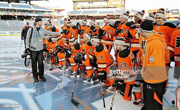 Photographer Brian Babineau sets up the Philadelphia Flyers team photo before the teams practice session at the 2012 Winter Classic on January 1 2012...