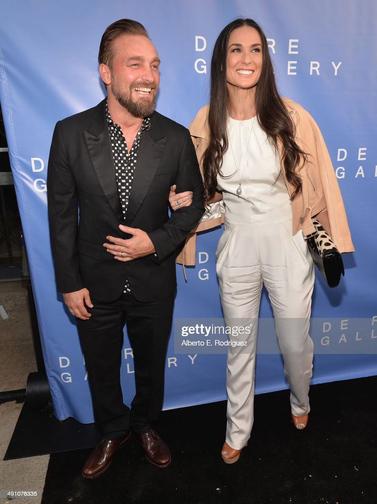Photographer Brian Bowen Smith and actress Demi Moore attend the opening of The De Re Gallery on May 15, 2014 in Los Angeles, California.