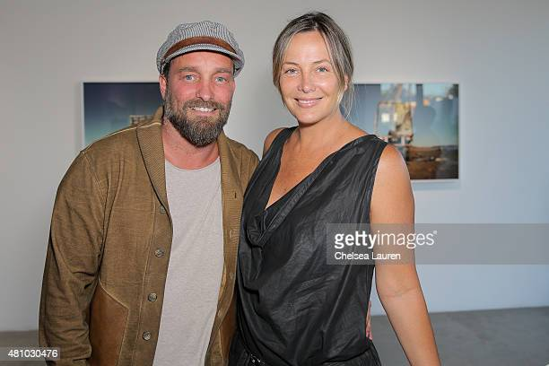 Photographer Brian Bowen Smith and Shea Bowen Smith attend the 'Desert Voices' opening exhibition at De Re Gallery on July 16 2015 in West Hollywood...