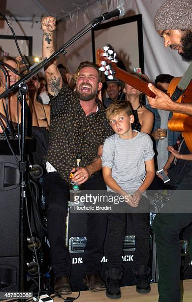 Photographer Brian Bowen Smith and son Jona attend his WILDLIFE show hosted by Casamigos Tequila at De Re Gallery on October 23 2014 in West...