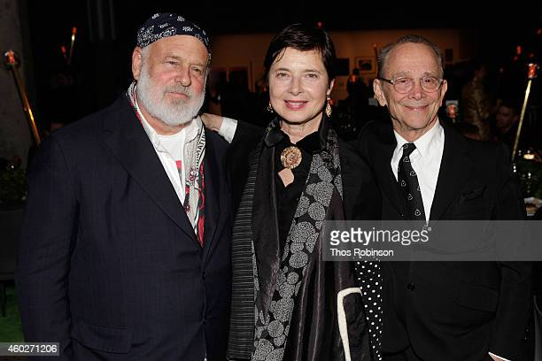 Photographer Bruce Weber and actors Isabella Rossellini and Joel Grey attend the 19th Annual ACRIA Holiday Dinner at Skylight Modern on December 10...