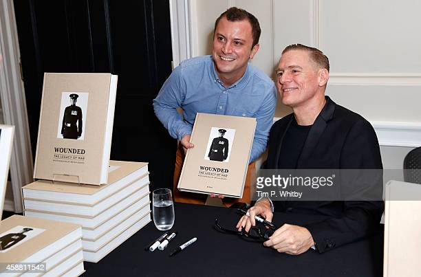 Photographer Bryan Adams poses witha fan at the private view of 'Wounded: The Legacy of War' at Somerset House on Remembrance Day, November 11, 2014...