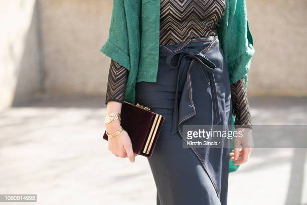 Photographer Candice Lake wears a Roland Mouret top skirt and jacket during London Fashion Week September 2018 on September 16 2018 in London England