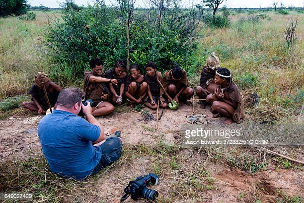 Photographer captures San Bushmen preparing breakfast in the desert.