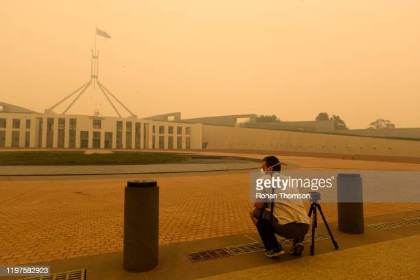 Photographer captures smoke at Parliament House on January 05, 2020 in Canberra, Australia. Smoke haze across Eastern Australian cities has become...