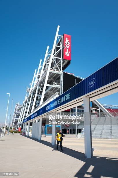Photographer carries his camera at Levi's Stadium, home to the San Francisco 49ers football team, in the Silicon Valley town of Santa Clara,...