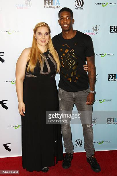 Photographer Cassy Athena and NBA player Delon Wright attends the EMotion Art Show on June 30 2016 in Los Angeles California