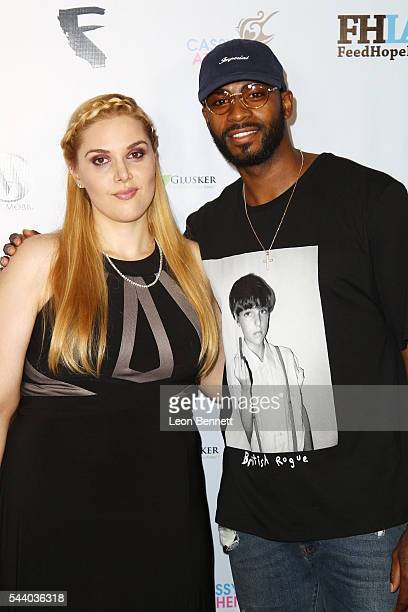 Photographer Cassy Athena and NBA player Dorell Wright attends the EMotion Art Show on June 30 2016 in Los Angeles California