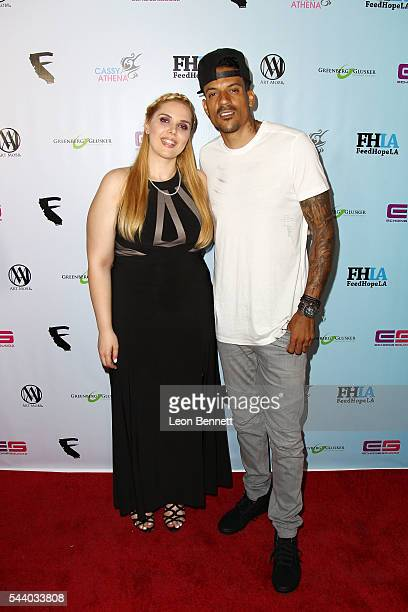 Photographer Cassy Athena and NBA player Matt Barnes attends the EMotion Art Show on June 30 2016 in Los Angeles California