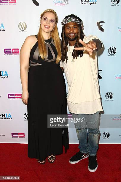 Photographer Cassy Athena and NFL player Omar Bolden attends the EMotion Art Show on June 30 2016 in Los Angeles California