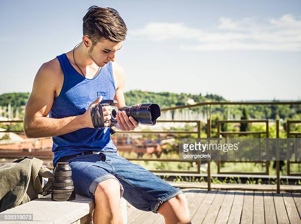 Photographer changing camera lens