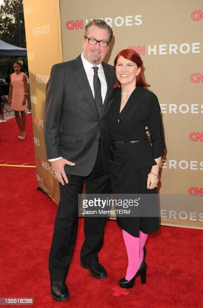 Photographer Chris Haston and actress Kate Flannery arrive at 2011 CNN Heroes An AllStar Tribute at The Shrine Auditorium on December 11 2011 in Los...