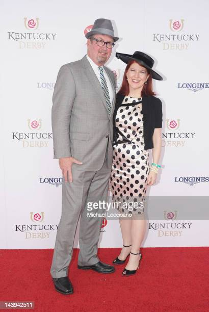 Photographer Chris Haston and actress Kate Flannery attend the 138th Kentucky Derby at Churchill Downs on May 5 2012 in Louisville Kentucky