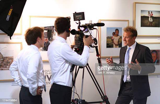 Photographer Chris Jackson gives an interview at the private view of 'Sentebale - Stories Of Hope' at Getty Images Gallery on July 25, 2013 in...