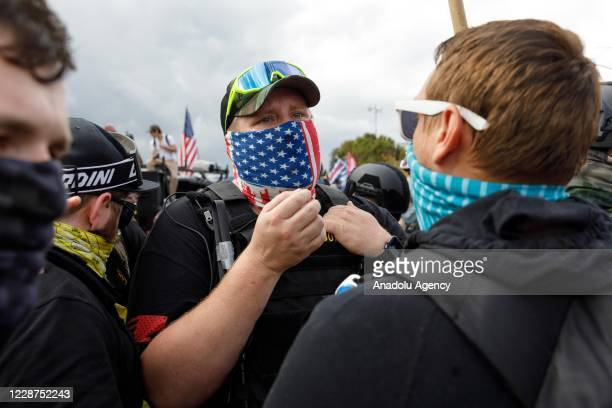 A photographer clashes with protesters as the Proud Boys a rightwing proTrump group gather with their allies in a rally called âEnd Domestic...