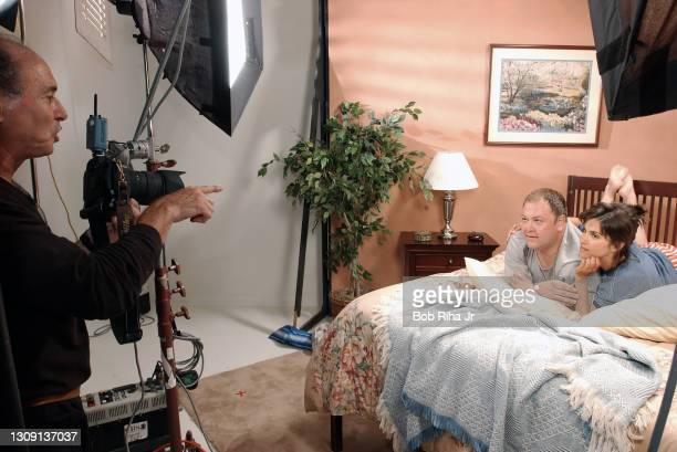 """Photographer Cliff Lipson photographs actors Jami Gertz and Mark Addy during photo session for new CBS television show """"Still Standing"""" starring..."""