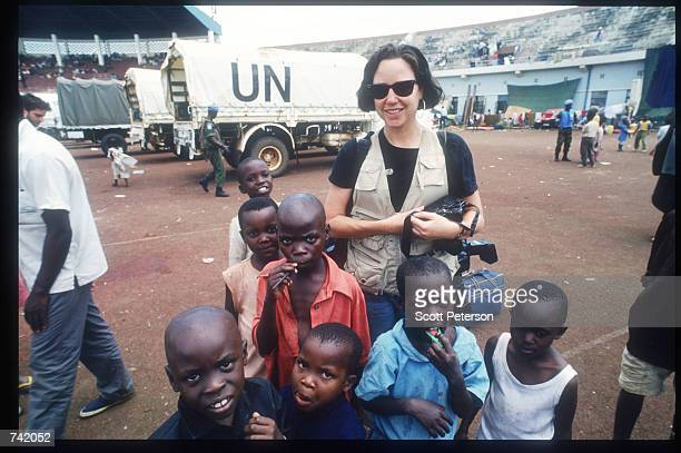 Photographer Corinne Dufka of Reuters poses with refugee children June 1994 in Rwanda Wellknown journalists descended on Rwanda during and after the...