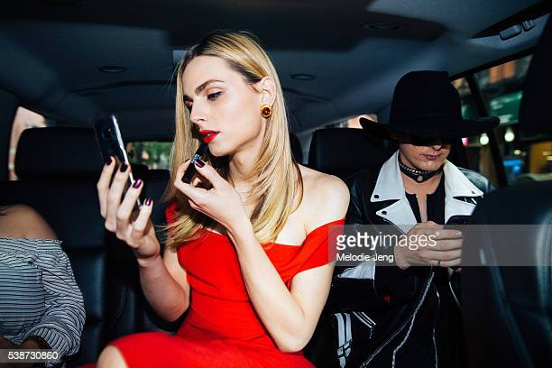 Photographer Damon Baker and Model Andreja Pejic wearing an red offshoulder draped Vivienne Westwood dress enter the Fragrance Awards at Alice Tully...