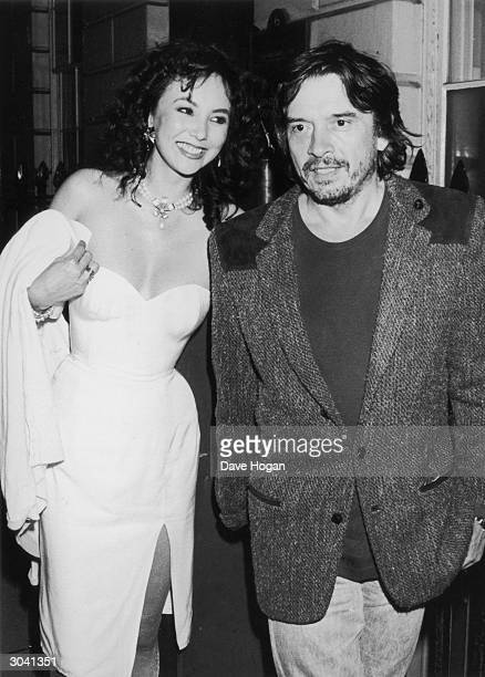 Photographer David Bailey and his wife fashion model Marie Helvin attend Michael Caine's Fourth of July party at Langan's Brasserie 9th July 1982