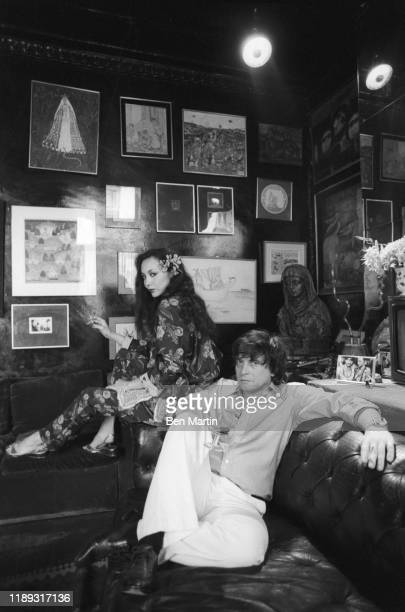 Photographer David Bailey and wife model Marie Helvin at home in London August 18th 1977