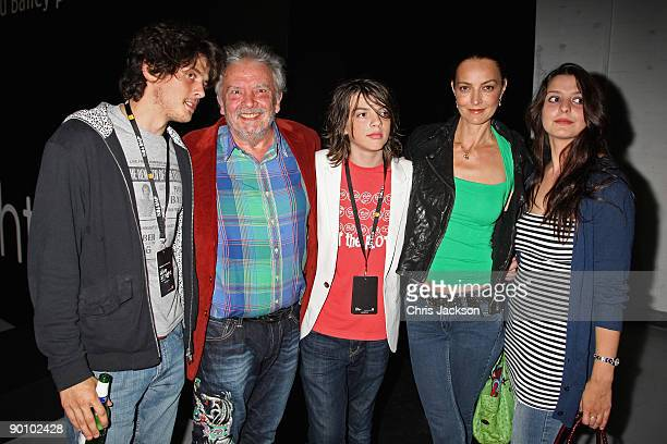 Photographer David Bailey his wife Catherine Bailey and their family pose for a photograph as they attend the Alive at Night private view and launch...