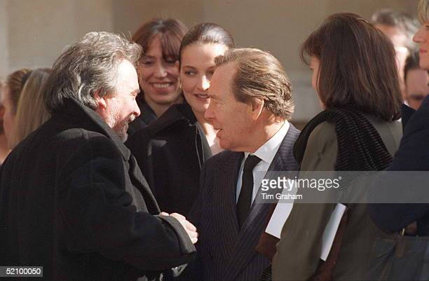 Photographer David Bailey Watched By His Wife Catherine Greets Lord Snowdon With His Wife Lucy At The Memorial Service For Terence Donovan