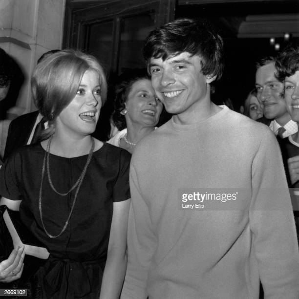 Photographer David Bailey with his bride, actress Catherine Deneuve.