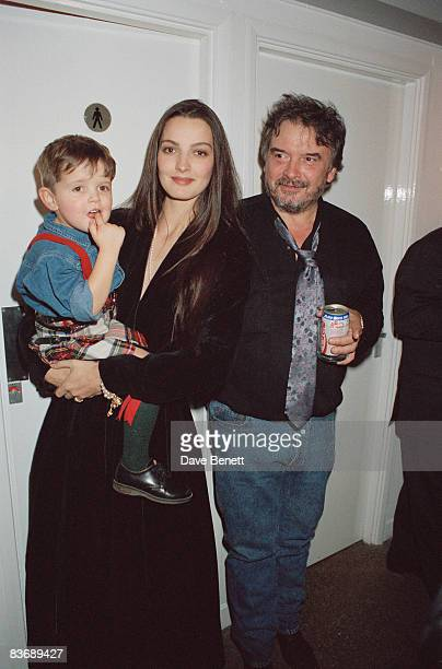 Photographer David Bailey with his wife Catherine and their son Fenton at an exhibition November 1990