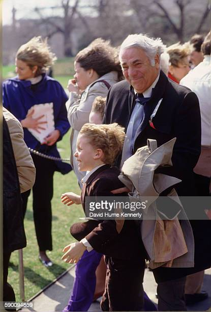 Photographer David Hume Kennerly's father, O.A. Kennerly , watching President Ronald Reagan's helicopter take off at the White House south lawn, with...