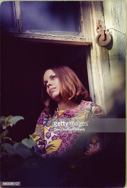 Photographer David Hume Kennerly's first wife, Susan Allwardt, poses at a window circa 1967 in New York City, New York.