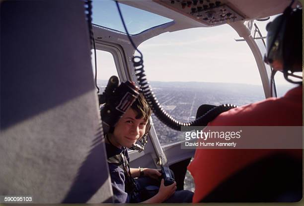 Photographer David Hume Kennerly's son Byron Kennerly on a helicopter while surveying the damages after the Northridge earthquake January 18 in Los...