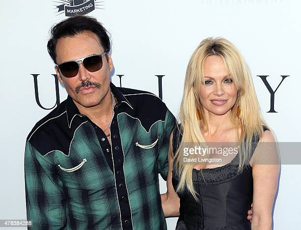Photographer David LaChapelle and actress Pamela Anderson attend the world premiere screening of the documentary 'Unity' at the DGA Theater on June...