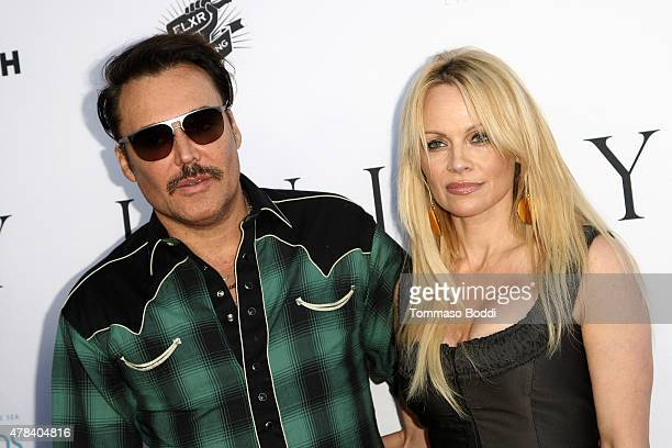 """Photographer David LaChapelle and actress Pamela Anderson attend the world premiere screening of documentary """"Unity"""" held at the DGA Theater on June..."""