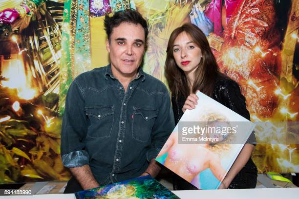 Photographer David LaChapelle and Charlotte Taschen attend the David LaChapelle book signing at TASCHEN Store Beverly Hills on December 17 2017 in...