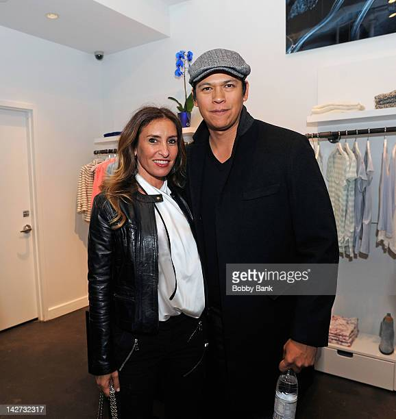 Photographer Debby Hymowitz and actor Chaske Spencer attends A Tribute to Mars Bar photo exhibit opening at Blue Cream on April 11 2012 in New York...