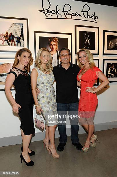 Photographer Denise Truscello model and television personality Holly Madison photographer Kevin Mazur and his wife Jennifer Mazur appear at the grand...