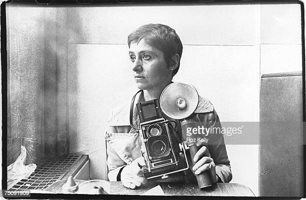 Photographer Diane Arbus poses for a rare portrait in the Automat at Sixth Avenue between 41st 42nd Street in New York New York circa 1968