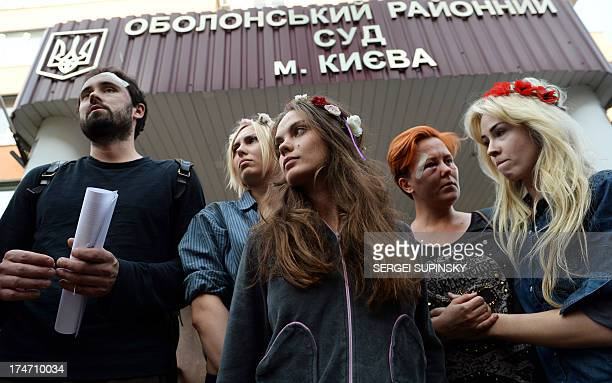 AFP photographer Dmitry Kostyukov and Femen activists Yana Zhdanova Oksana Shachko Anna Hutsol and Oleksandra Shevchenko leave the district court in...