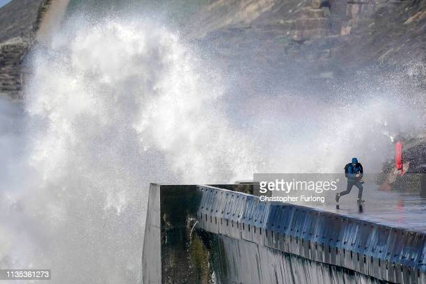 A photographer dodges a wave in the winds of Storm Gareth and the high tide at Blackpool on March 12 2019 in Blackpool United Kingdom The Met Office...