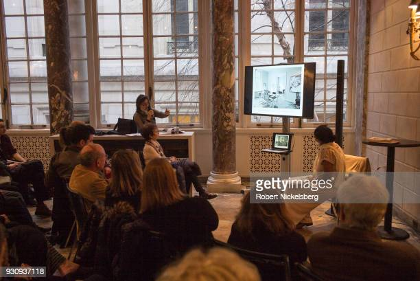 Photographer Dominique Nabokov center speaks to a crowd about her new book Berlin Living Rooms at the Albertine Book Store March 3 2018 in New York...