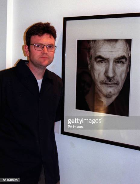 Photographer Donald Maclellan in front of his portrait of actor Brian Cox at an exhibition of his photography at the National Portrait Gallery in...