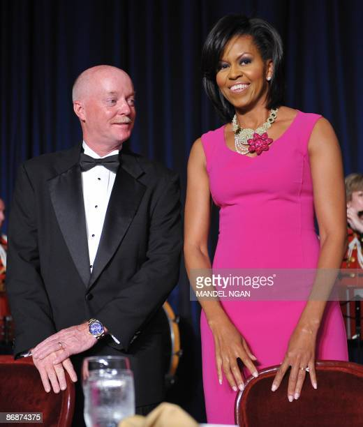 Photographer Doug Mills of the New York Times stands next to First Lady Michelle Obama at the White House Correspondents� Association annual dinner...