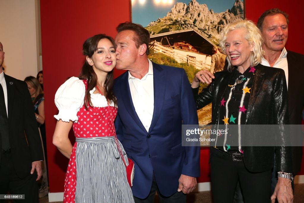 Photographer Ellen von Unwerth and Arnold Schwarzenegger ((C), and Charlotte Taschen (L) during the opening night of Ellen von Unwerth's photo exhibition at TASCHEN Gallery on February 24, 2017 in Los Angeles, California.