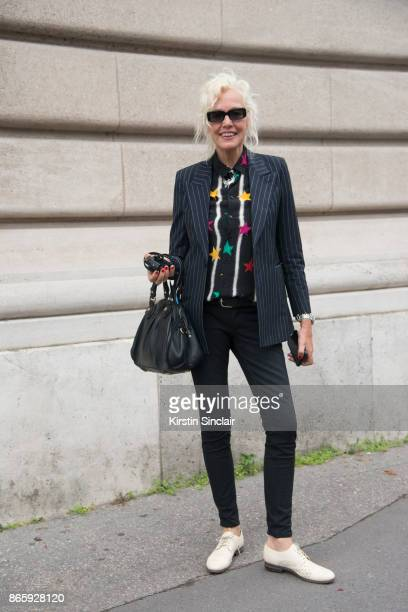 Photographer Ellen Von Unwerth wears a Saint Laurent jacket and shirt Hedi Slimane pants and Marc Jacobs bag day 2 of Paris Womens Fashion Week...