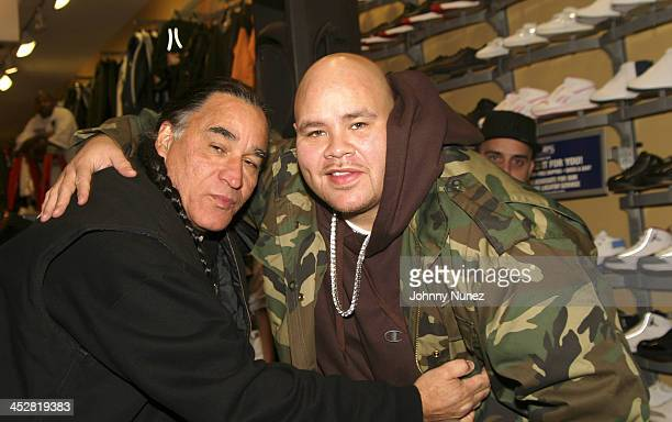 Photographer Ernie Paniccioli and Fat Joe during Joint Chief's Autograph Signing November 23 2004 at Champs Sports 125th Street in New York New York...
