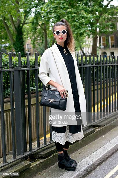 Photographer Eva Al Desnudo wears a Topshop coat Pins and Needles shirt Uterque bag Vagabond shoes Sparkle and Fade dress and Urban Outfitters...