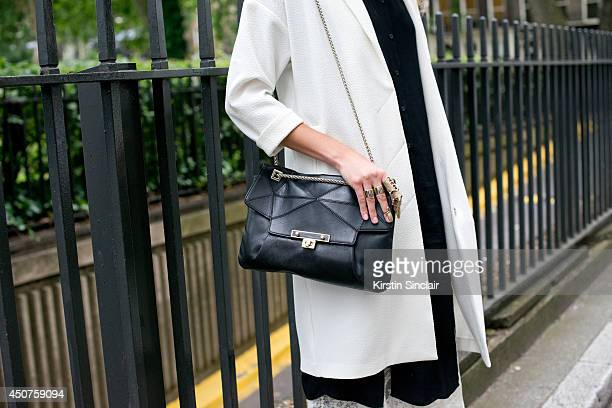 Photographer Eva Al Desnudo wears a Topshop coat Pins and Needles shirt Uterque bag on day 1 of London Collections Men on June 15 2014 in London...